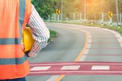 TechnikBauunternehmen, baut eine neue Straße Funktion auf Lizenzfreies Stockbild