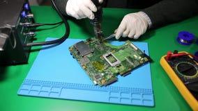 Techniker Solders Circuit Board stock footage
