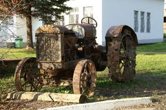 Very old tractor, standing now idle. stock images