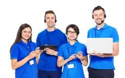 Technische ondersteuningexploitanten met hoofdtelefoons stock foto's