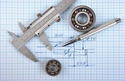 Technische Zeichnung und Tasterzirkel Stockbilder
