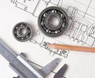 Technische Zeichnung und Tasterzirkel Stockbild