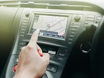 Technnology en coche con el navegador de GPS para la cosechadora con el interior Imagen de archivo