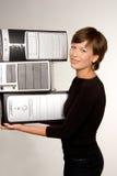 Techno burden. Pretty girl carrying three computers Stock Photo