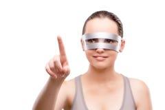 Techno dziewczyna naciska wirtualnego guzika odizolowywającego na bielu Zdjęcia Royalty Free