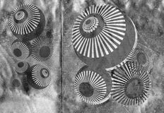 Techno shapes on metallic silver Stock Images