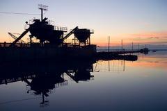 Techno and sunset. Salt lake (Saki, Crimea; Ukraine); silt  therapeutic muds Royalty Free Stock Image