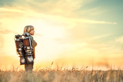 Technologic. Boy with a backpack at sunset Royalty Free Stock Images