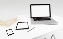 Technologic devices with empty screen on desktop Royalty Free Stock Images