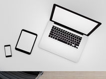 Technologic devices with empty screen on desktop. Laptop, tablet pc and smart phone on office desktop. White empty screen with copy space. 3d rendered Stock Image