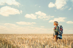 Technologic. Little boy with a backpack outdoors Stock Photo