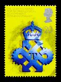 Technological Achievement Award, 25th Anniversary of Queen`s Award for Export and Technology serie, circa 1990. MOSCOW, RUSSIA - OCTOBER 3, 2017: A stamp printed Royalty Free Stock Photos