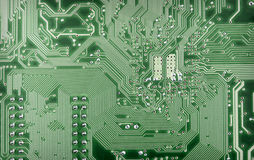 Technological background from green computer plate Royalty Free Stock Photo