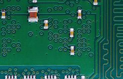 Technological background. Part of a computer chip. Macro photo of modern chipset. Royalty Free Stock Photography