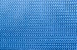 Technological blue background ribbed. Top view Stock Images