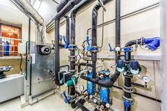 Technological boiler unit with tanks, pipelines and chimney Royalty Free Stock Photography