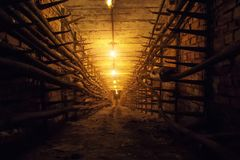 Technological communication underground tunnel with electrical cables.  stock photo