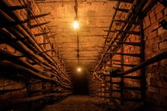 Technological communication underground tunnel with electrical cables.  royalty free stock photo