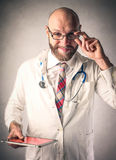 Technological doctor. Using a tablet Royalty Free Stock Image