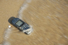 Technological flotsam 6. Mobile-Phone was washed ashore stock photos
