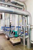 Technological industrial boiler unit with piping and pumps Stock Photo