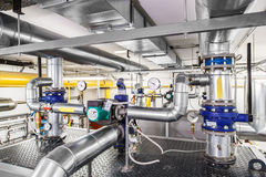 Technological industrial boiler unit with piping and pumps Stock Photos