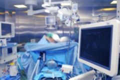 Technological infrastructure of operating room during surgery, u. Nfocused background royalty free stock image
