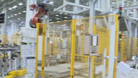 Technological production line at the plant. Scene. Team welding robots represent the movement. In the automotive parts. Industry stock footage