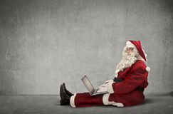A technological Santa Claus Stock Images