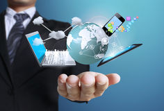 Technologie dans les mains Photographie stock libre de droits