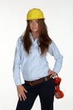 Technologie femelle dans le casque antichoc photographie stock libre de droits