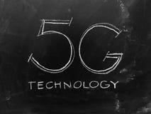 Technologie 5G handgeschrieben auf Tafel Lizenzfreies Stockfoto