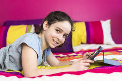 Technologies become easier. Cute little girl holding digital tablet Royalty Free Stock Image