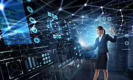 Technologies that impress. Mixed media . Mixed media. Young businesswoman or IT manager with laptop in hands in connection cyberspace. 3D rendering Royalty Free Stock Images