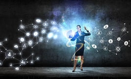 Technologies that impress . Mixed media. Young businesswoman or IT manager with laptop in hands in connection cyberspace. 3D rendering Royalty Free Stock Photography