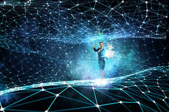 Technologies that impress . Mixed media. Young businesswoman or IT manager with laptop in hands in connection cyberspace. 3D rendering Royalty Free Stock Images
