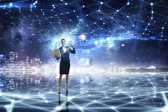 Technologies that impress . Mixed media. Young businesswoman or IT manager with laptop in hands in connection cyberspace. 3D rendering Royalty Free Stock Photo