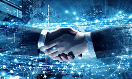 Technologies to connect people . Mixed media. Business handshake against social network background. 3D rendering Stock Photo