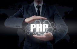 Technologii i interneta pojęcie - biznesmen trzyma php guzika na wirtualnych ekranach Zdjęcia Stock