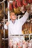 Technologist posing with wurst and jamon Royalty Free Stock Photo
