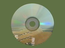 Technology. A CD-ROM showing an electronic circuit projected on it stock illustration