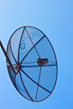Technology. Satellite and blue sky background Royalty Free Stock Image