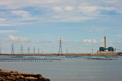 Technology. Power plant on the beach Stock Image