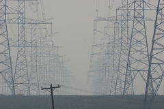 Technology. Power lines in the mist Royalty Free Stock Images