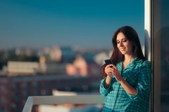 Girl checking her phone first thing in the morning Royalty Free Stock Photography