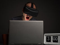 Technology addicted man with insomnia. Crazy man addict to technology and virtual reality with insomnnia. Technology addiction and mental disorders concept Royalty Free Stock Image