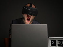 Technology addicted man with insomnia. Crazy man addict to technology and virtual reality with insomnnia. Technology addiction and mental disorders concept Stock Photos
