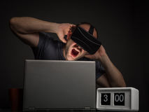 Technology addicted man with mental disorders. Crazy man addict to technology and virtual reality. Technology addiction and mental disorders concept Stock Image
