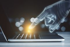 Technology, AI and device concept. Close up of digital hand using glowing laptop on blurry toned background. Technology, AI and device concept royalty free stock photography