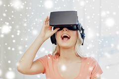 Woman in virtual reality headset or 3d glasses. Technology, augmented reality, cyberspace, entertainment and people concept - happy amazed young woman in virtual Royalty Free Stock Photos